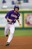 LSU Tigers outfielder Mark Laird #9 runs to third base against the Auburn Tigers in the NCAA baseball game on March 23, 2013 at Alex Box Stadium in Baton Rouge, Louisiana. LSU defeated Auburn 5-1. (Andrew Woolley/Four Seam Images).