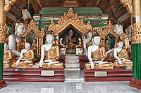 Myanmar, Burma.  Shwedagon Pagoda, Yangon, Rangoon.  One of many Buddha shrines at the Pagoda.