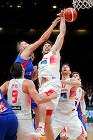 France's Joffrey Lauvergne (L) vies with Spain's Pau Gasol (R) during European championship semi-final basketball match between France and Spain on September 17, 2015 in Lille, France  (credit image & photo: Pedja Milosavljevic / STARSPORT)
