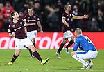 Jamie Walker celebrates his goal as Kenny Miller is dejected