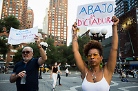 NEW YORK, NEW YORK - JULY 14: A man and woman with banners rally in support of Cuban protesters in Union Square Park on July 14, 2021 in New York City. A small group of people gathered in Union Square Park in support of the Cuban people who have been protesting against the communist regime due to food shortages and the worsening of the economic crisis that has been exasperated by the coronavirus pandemic (COVID-19) . The protest on the island has been the largest protest against the government in decades. (Photo by Pablo Monsalve / VIEWpress via Getty Images)