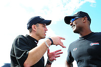 Aug. 19, 2011; Brainerd, MN, USA: NHRA top fuel dragster driver Larry Dixon (left) talks with Antron Brown during qualifying for the Lucas Oil Nationals at Brainerd International Raceway. Mandatory Credit: Mark J. Rebilas-
