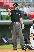 Home plate umpire Travis Carlson makes a strike call during the International League game between the Toledo Mud Hens and the Charlotte Knights at Knights Stadium on May 8, 2012 in Fort Mill, South Carolina.  (Brian Westerholt/Four Seam Images)