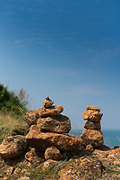 Stack of stones in Phuket with Andaman sea behind, Thailand