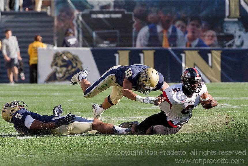Pitt defensive backs K'Waun Williams (2) and Jarred Holley (18) tackle Gardner-Webb wide receiver Richard Jules (2). The Pitt Panthers defeated the Gardner-Webb Runnin Bulldogs 55-10 at Heinz Field, Pittsburgh PA on September 22, 2012..