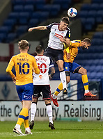 Bolton Wanderers' Ryan Delaney wins an aerial battle<br /> <br /> Photographer Andrew Kearns/CameraSport<br /> <br /> The EFL Sky Bet League Two - Bolton Wanderers v Mansfield Town - Tuesday 3rd November 2020 - University of Bolton Stadium - Bolton<br /> <br /> World Copyright © 2020 CameraSport. All rights reserved. 43 Linden Ave. Countesthorpe. Leicester. England. LE8 5PG - Tel: +44 (0) 116 277 4147 - admin@camerasport.com - www.camerasport.com