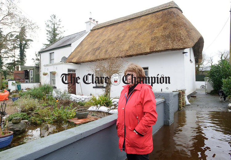 Bridie Willers outside her home and that of her nephew Niall Fahy which were flooded at Granagh, Ardrahan. Photograph by John Kelly.