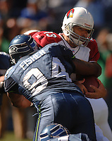 Sep 25, 2005; Seattle, WA, USA; Arizona Cardinals quarterback #13 Kurt Warner is sacked by Seattle Seahawks defensive end Bryce Fisher in the first quarter at Qwest Field. Mandatory Credit: Photo By Mark J. Rebilas
