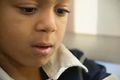 MR / Schenectady, NY. Zoller Elementary School (urban public school). Kindergarten inclusion classroom. Facial closeup of student (boy, 5, African-American) in classroom. MR: Ste14. ID: AM-gKw. © Ellen B. Senisi.