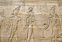 Bas-reliefs showing Egyptian gods at the temple of Edfu in Egypt