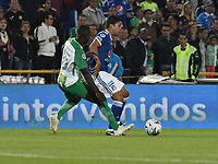 BOGOTÁ - COLOMBIA, 11-01-2019: Cristian Marrugo (Der.) jugador de Millonarios disputa el balón con Deiver Machado (Izq.) jugador de Atlético Nacional, durante partido entre Millonarios y Atlético Nacional, por el Torneo Fox Sports 2019, jugado en el estadio Nemesio Camacho El Campin de la ciudad de Bogotá. / Cristian Marrugo (R) player of Millonarios vies for the ball with Jerson Candelo (L) during a match between Millonarios y Atletico Nacional, for the Fox Sports Tournament 2019, played at the Nemesio Camacho El Campin stadium in the city of Bogota. Photo: VizzorImage / Luis Ramírez / Staff.