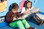 Education Preschool 3-4 year olds two girls sitting side by side looking a picture books