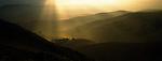 Shafts of sunlight on farmland near Teddington, the Canterbury Region of New Zealand.