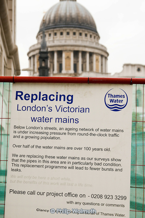Private contractors working for Thames Water replaing water mains near St Paul's Cathedral in the City of London