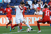 Josh Simpson midfielder Canada gets into the Panama penalty box...Canada and Panama played to a 1-1 tie in Gold Cup play at LIVESTRONG Sporting Park. Kansas City Kansas.