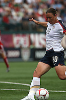USWNT's Abby Wambach (20) scores her 100th career goal in the second half. The U.S. Women's National Team defeated Canada 1-0 in a friendly match at Marina Auto Stadium in Rochester, NY on July 19, 2009.