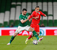 27th March 2021; Aviva Stadium, Dublin, Leinster, Ireland; 2022 World Cup Qualifier, Ireland versus Luxembourg; Enda Steven (Republic of Ireland) and Vincent Thill (Luxembourg) challenge for the ball