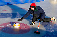 A womn competes in the curling competition during the Fur Rondy Festival, downtown Anchorage.
