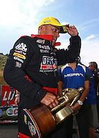 Jul. 20, 2014; Morrison, CO, USA; NHRA top fuel driver J.R.Todd celebrates after winning the Mile High Nationals at Bandimere Speedway. Mandatory Credit: Mark J. Rebilas-
