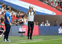28th May 2018, Wembley Stadium, London, England;  EFL League 2 football, playoff final, Coventry City versus Exeter City; Exeter City manager Paul Tisdale catches the ball as it goes out of play
