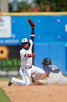 Dunedin Blue Jays shortstop Ivan Castillo (1) holds his glove in the air after tagging Derek Hill (18) during a game against the Lakeland Flying Tigers on May 27, 2018 at Dunedin Stadium in Dunedin, Florida.  Lakeland defeated Dunedin 2-1.  (Mike Janes/Four Seam Images)