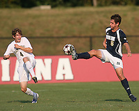 04 September 2009: Michael Thomas #8 of the University of Notre Dame flicks the ball over Justin Lichtfuss #4 of Wake Forest University during an Adidas Soccer Classic match at the University of Indiana in Bloomington, In. The game ended in a 1-1 tie..