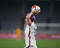 TOKYO, JAPAN - JULY 21: Megan Rapinoe #15 of the United States takes throw in during a game between Sweden and USWNT at Tokyo Stadium on July 21, 2021 in Tokyo, Japan.