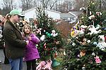 NEWTOWN, CT-17 December 2012-121712LW12 - Cathy Breen Austermann, left, and her daughter Haley Austermann, 7, of Newtown, visit the evergreen memorials near the entrance of Sandy Hook Elementary School in Newtown Monday. Laraine Weschler