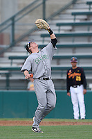 John Schuknecht #2 of the Cal Poly Mustangs waits under a pop up at first base during a game against the USC Trojans at Dedeaux Field on March 2, 2014 in Los Angeles, California. Cal Poly defeated USC, 5-1. (Larry Goren/Four Seam Images)