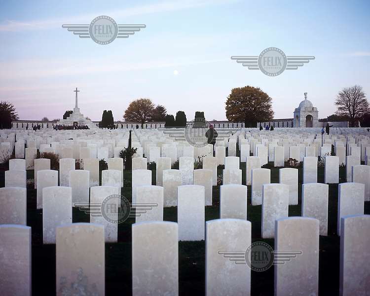 Headstones and The Cross of Sacrifice at Tyne Cot, the biggest Commonwealth War Cemetery in the world where almost 12,000 men, killed in the Ypres Salient during World War I, are laid to rest.