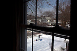 """All three """"boys"""" pause in our neighbor's yard after Ted and Sam shoveled our sidewalk and our neighbor's sidewalks. Sam is four and a half and Eli is 20 months."""