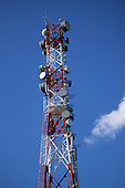 Brasov, Romania. Tall red and white telecom tower with satelite dishes.