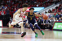 RALEIGH, NC - JANUARY 9: Prentiss Hubb #3 of the University of Notre Dame is defended by Devon Daniels #24 of North Carolina State University during a game between Notre Dame and NC State at PNC Arena on January 9, 2020 in Raleigh, North Carolina.