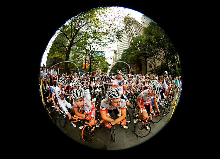 Hundreds of cyclists raced bikes through the streets of downtown / uptown Charlotte, NC, during the 2009 annual Presbyterian Hospital Invitational Criterium. The bicycle criterium attracted professional cyclists to compete in one of the top criterium races in the country for both men and women. In addition to drawing such top racers as Katherine Carroll and Alejandro Borraja, the popular spectator sport event raises money and awareness for the Brain Tumor Fund for the Carolinas.