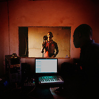 Kuduru/Kuduro musicians recording in a studio in Sambizanga musseque (slum). It is the heart of Angola's Kuduru music scene and contains many self-built studios that have been haphazardly attached onto the roofs or sides of houses. ..
