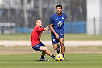 BRADENTON, FL - JANUARY 23: Chris Mueller, Miles Robinson battle for a ball during a training session at IMG Academy on January 23, 2021 in Bradenton, Florida.