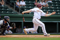 Catcher Alex Swim (27) of the Elon Phoenix bats in a game against the Furman Paladins in a first-round Southern Conference playoffs game on Wednesday, May 22, 2013, at Fluor Field at the West End in Greenville, South Carolina. Furman won, 10-1. The catcher is Furman's Paul Nitto (18). (Tom Priddy/Four Seam Images)