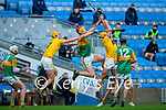 Michael O'Leary, Kerry in action against Joe Maskey, and Michael Bradley, Antrim during the Joe McDonagh Cup Final match between Kerry and Antrim at Croke Park in Dublin.