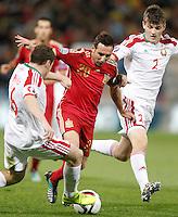 Spain's Santi Cazorla (c) and Belarus' Sergei Balanovich (l) and Stanislav Dragun during 15th UEFA European Championship Qualifying Round match. November 15,2014.(ALTERPHOTOS/Acero) /NortePhoto nortephoto@gmail.com