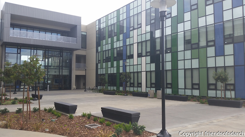 Mesa Community College Social & Behavioral Sciences Building, San Diego. Completed in 2014. Courtyard spaces with flowering trees and colorful drought tolerant shrubs. Marian Marum, Landscape Architect.