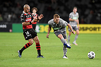 6th April 2021; Bankwest Stadium, Parramatta, New South Wales, Australia, Australian A League football, Western Sydney Wanderers versus Central Coast Mariners; Oliver Bozanic of Central Coast Mariners passes the ball as James Troisi of Western Sydney Wanderers covers