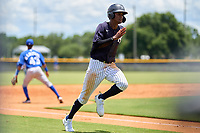 FCL Yankees Alexander Vargas (14) scores a run during a game against the FCL Blue Jays on June 29, 2021 at the Yankees Minor League Complex in Tampa, Florida.  (Mike Janes/Four Seam Images)