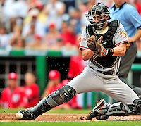 24 May 2009: Baltimore Orioles' catcher Chad Moeller is unable to hold onto the ball as a run scores in the fifth inning during a game against the Washington Nationals at Nationals Park in Washington, DC. The Nationals rallied to defeat the Orioles 8-5 and salvage a win in their interleague series. Mandatory Credit: Ed Wolfstein Photo