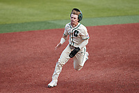 Dominic Pilolli (22) of the Charlotte 49ers hustles towards third base against the Old Dominion Monarchs at Hayes Stadium on April 25, 2021 in Charlotte, North Carolina. (Brian Westerholt/Four Seam Images)