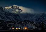 Base Camp, Mount Everest, Tibet, China<br /> <br /> Climbers' tents in the Rongbuk Valley base camp are illuminated by lantern light, while Everest looms above, illuminated by the moon.<br /> <br /> Nikon F3, Nikkor 80-200mm lens, f/2.8 for 10 minutes, Kodachrome 64 film