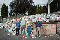 Northwest Recycling CEO Kevin Moore, Bellingham Public Works Director Ted Carlson, Northwest Recycling Operations Manager Marty Kuljis and Sanitary Service Company Recycling Manager Rodd Pemble, photographed at Northwest Recycling in Bellingham, Wash. Bellingham is one of only a handful of cities in Washington state without single-stream recycling, so residents must sort their recyclable items into three separate bins. Photo by Daniel Berman