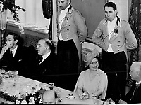 La visite du Roi George VI au Canada en 1939.<br /> <br /> <br /> <br /> <br /> <br /> La visite du Roi George VI au Canada en 1939.<br /> <br /> <br /> <br /> <br /> <br /> The king smokes a cigarette after luncheon in Quebec city; shortly before making his first address on Canadain soil. Next to him is Prime Minister King; and on the right the Queen smilingly chats with Hon. E. L. Patenaude; lieutenant-governor of Quebec.<br /> <br /> [unknown]<br /> Picture, 1939<br /> <br /> PHOTO : Toronto Star Archives - AQP