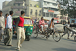 Street traffic and pedestrians in New Delhi, India.