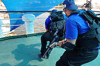 Trainees take part in a training course to fight maritime terror and piracy, on a boat in Haifa Port....