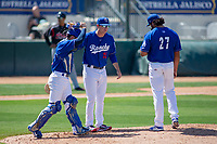 Rancho Cucamonga Quakes Pitching Coach Connor McGuinness  makes a mound visit with Chris Mathewson (27) and Connor Wong (33) at LoanMart Field on May 28, 2018 in Rancho Cucamonga, California. The Storm defeated the Quakes 8-5.  (Donn Parris/Four Seam Images)